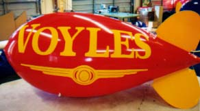 Advertising Blimps - Voyle's logo - custom helium balloons made in the USA.